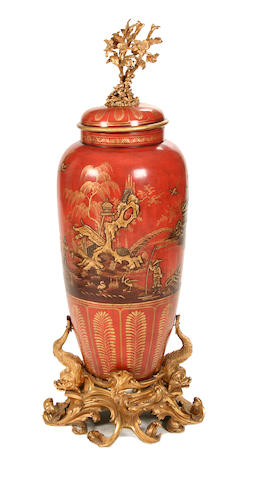 An 18th century style chinoiserie decorated urn on stand