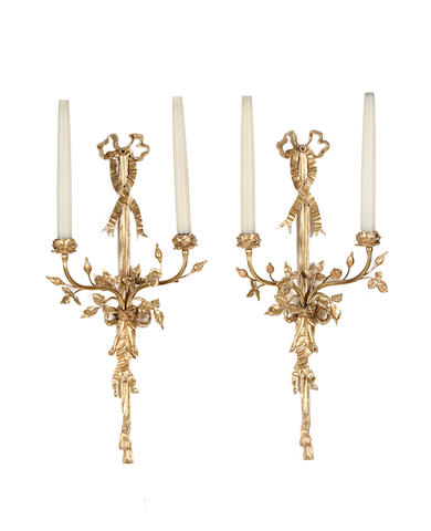 A pair of Louis XVI style gilt metal twin branch wall lights