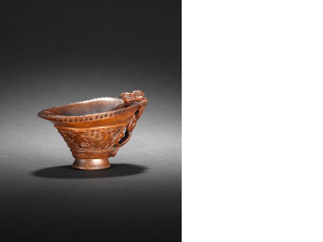 An archaistic rhinoceros horn libation cup  17th/18th century