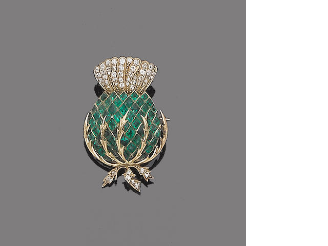 An early 20th century emerald and diamond brooch