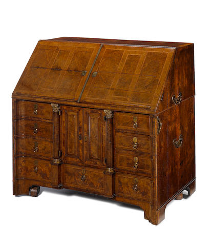 An important early 18th century figured walnut, crossbanded and featherbanded bureau
