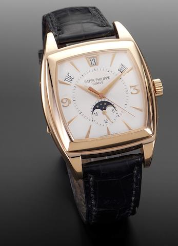 Patek Philippe. An 18ct pink gold automatic wristwatch with calendar and moonphase Reference 5135R, Recent