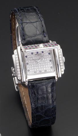 Piaget. An unusual lady's 18ct white gold quartz diamond, ruby, sapphire and emerald set concealed wristwatchCase No.628521, Recent