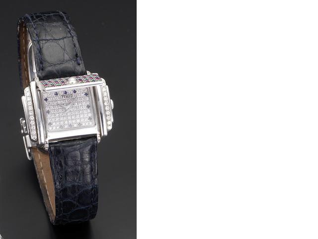 Piaget. An unusual lady's 18ct white gold quartz diamond, ruby, sapphire and emerald set concealed wristwatch Case No.628521, Recent