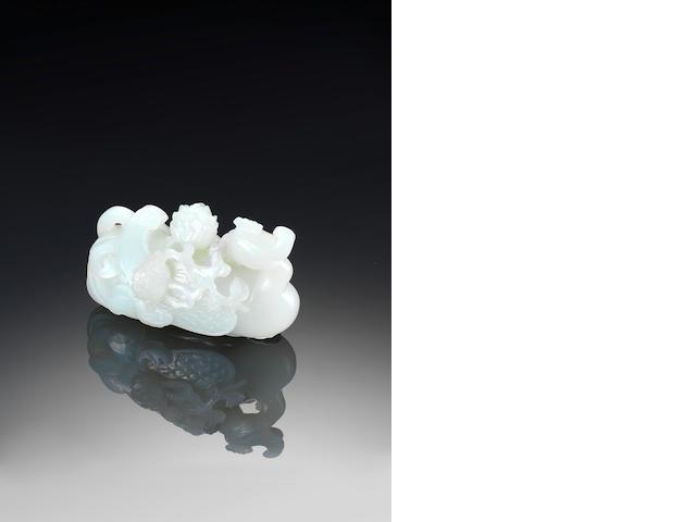 A fine white jade recumbent phoenix 18th century