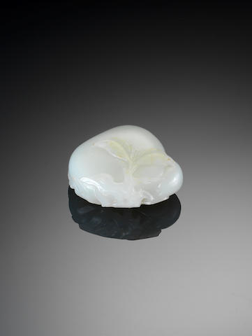 A white jade group of a peach and bat 18th century