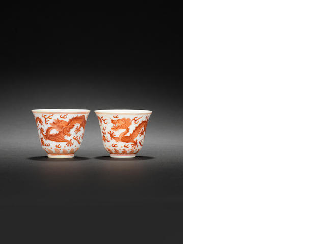 A pair of iron-red 'dragon' wine cups Guangxu six-character mark and of the period