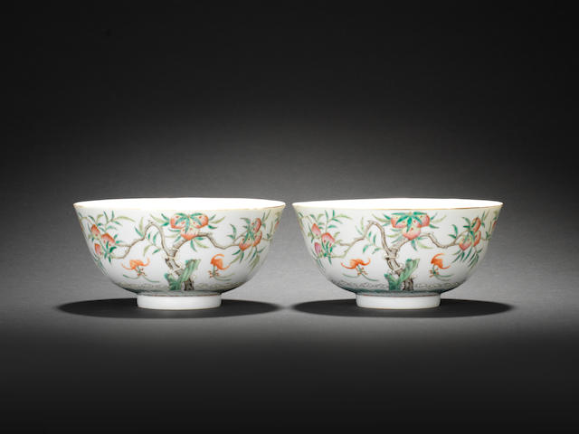 A pair of famille rose 'bats and peaches' bowls  Guangxu six-character mark and of the period