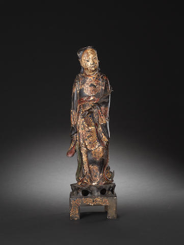 A gilt and lacquered figure of a lady Ming Dynasty