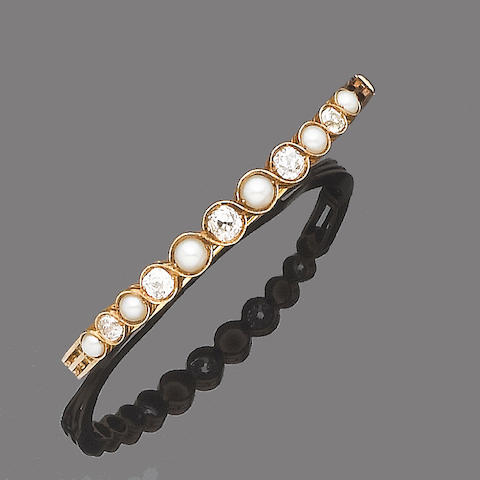 A half-pearl and diamond hinged bangle,