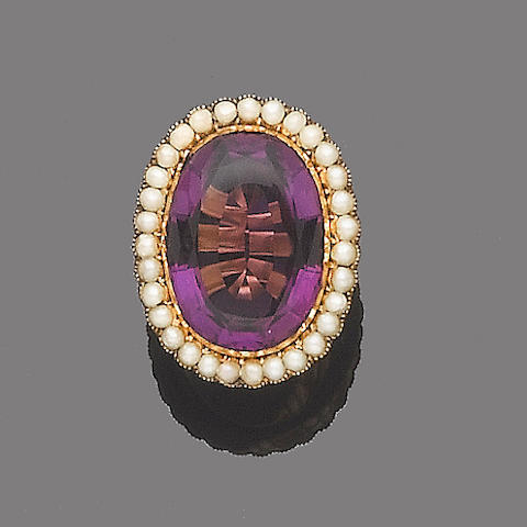An early 20th century amethyst and half-pearl ring