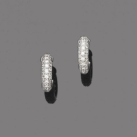 A pair of diamond earhoops, by Cartier