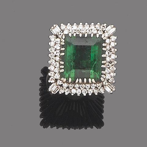 A green tourmaline and diamond dress ring