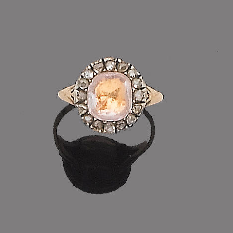 A topaz and diamond cluster ring,