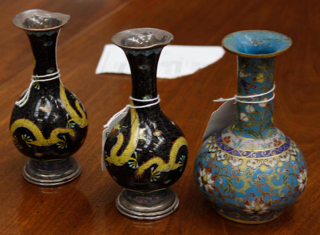 A Chinese cloisonne enamel small vase,pale blue ground and a pair of small cloisonne black ground vases.