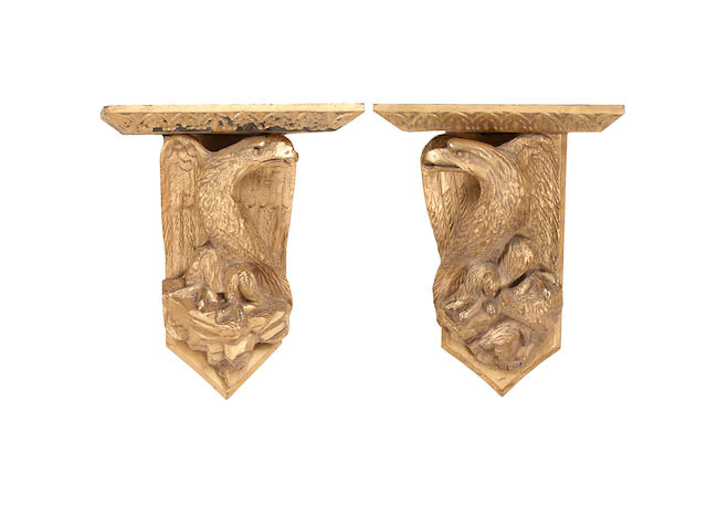 A pair of George III style gold painted and carved wood wall brackets modelled as eagles