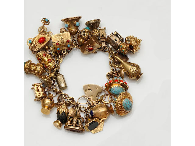 An 18ct gold curb-link charm bracelet