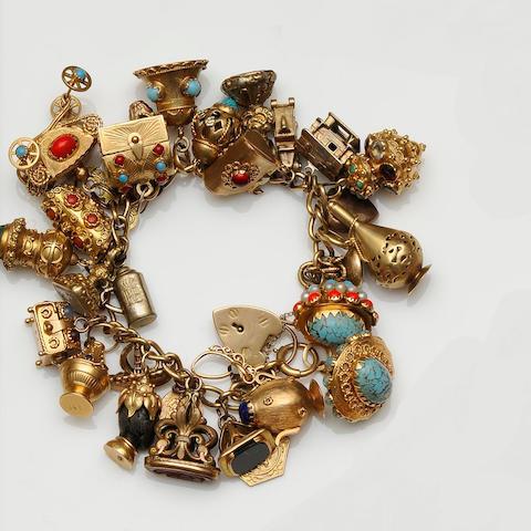 An 18ct gold curb-link charm bracelet