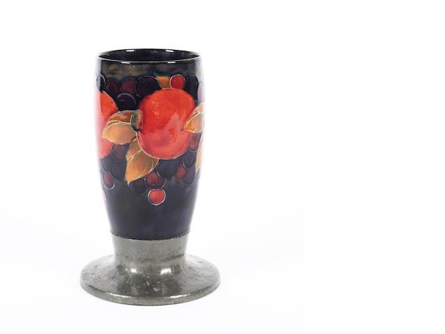 A William Moorcroft Tudric  pewter mounted vase