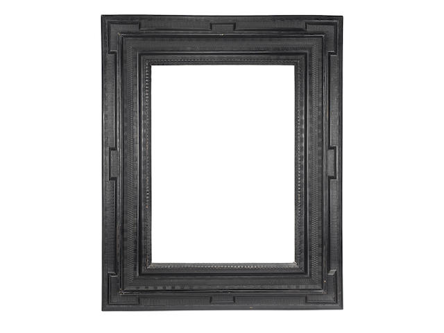 A large Dutch 17th Century ebony ripple moulding frame