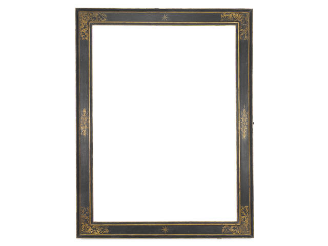 An Italian 17th Century carved, ebonised and parcel gilt cassetta frame