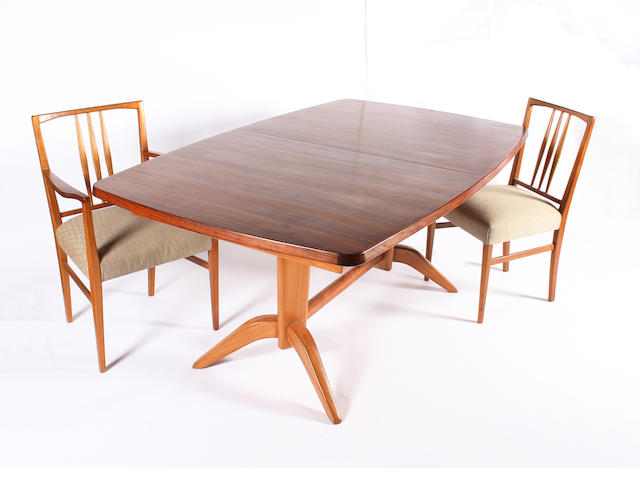 A Gordon Russell rosewood and mahogany extending dining table and a set of eight mahogany chairs, designed by W.H. Russell, circa 1950