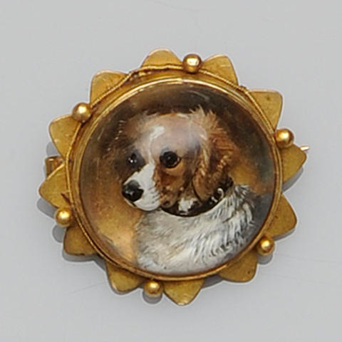 A Victorian circular reverse painted crystal brooch