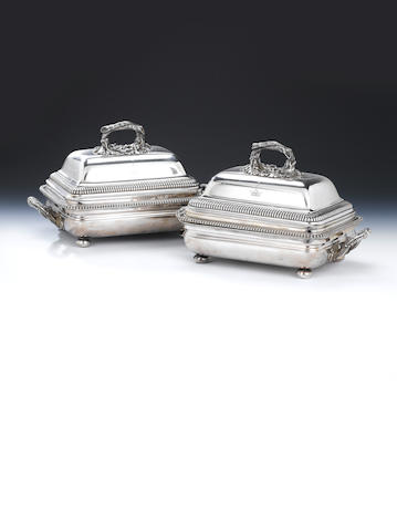 A pair of George III silver entrée dishes and covers the dishes by Philip Rundell, London 1820, the covers by John Bridge, London 1826,