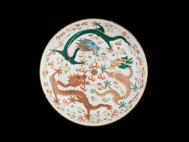 Two famille rose 'dragon' saucer dishes Iron-red Guangxu six-character marks and of the period