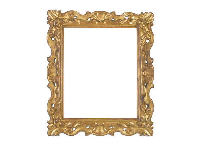 A Florentine 17th Century carved, pierced, swept and gilded frame