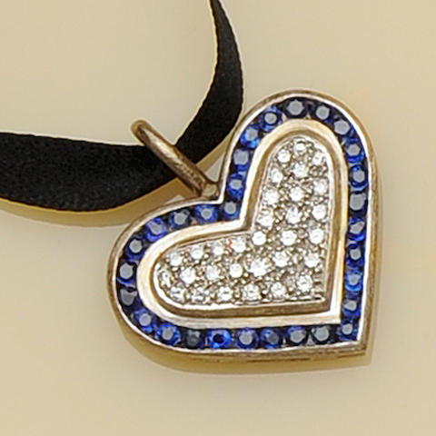 A sapphire and diamond heart pendant