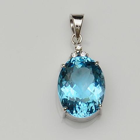 A blue topaz and diamond pendant