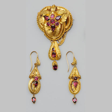 A Victorian almandine garnet set brooch and earpendant suite