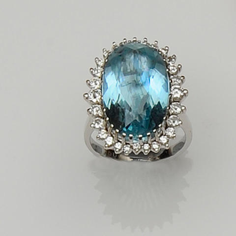 An aquamarine and diamond cluster dress ring