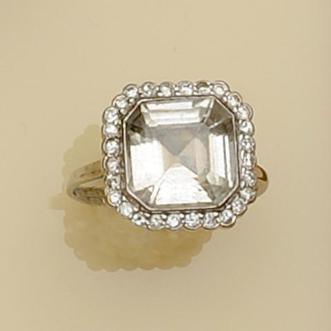 A diamond and white stone square cluster dress ring