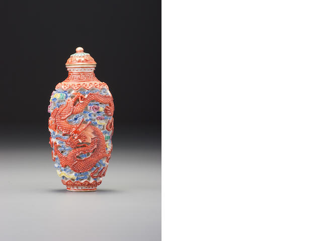 A moulded 'famille-rose' porcelain 'dragon and phoenix' snuff bottle Imperial kilns