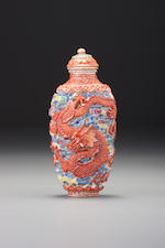 A moulded 'famille-rose' porcelain 'dragon and phoenix' snuff bottle Imperial kilns, Jingdezhen, Jiaqing iron-red seal mark and of the period, 1796–1820