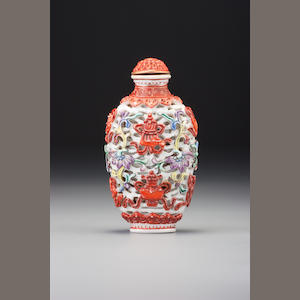 A moulded 'famille-rose' porcelain 'ba jixiang' snuff bottle Imperial kilns, Jingdezhen, Jiaqing iron-red seal mark and of the period, 1796–1820