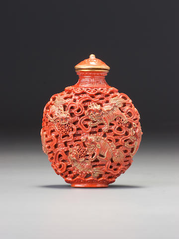 A moulded 'famille-rose' porcelain 'nine Buddhist lions' snuff bottle Imperial kilns, Jingdezhen, Jiaqing gold-enamelled seal mark and of the period, 1796–1820