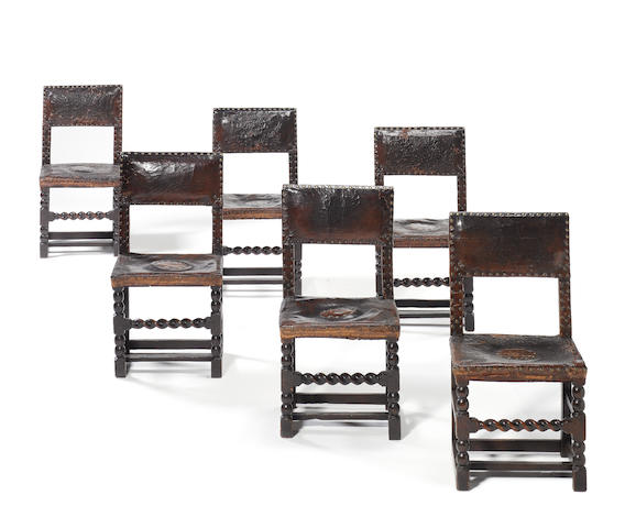 A set of six Charles II oak and upholstered chairs