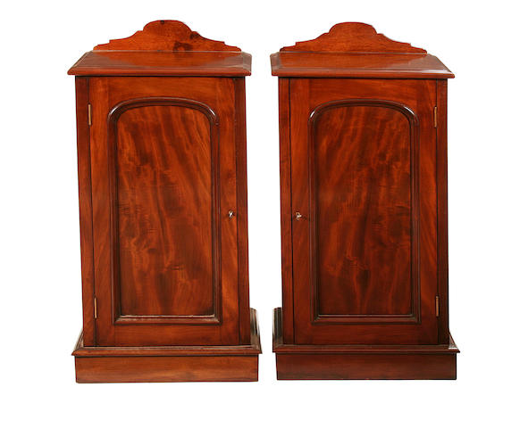 A pair of Victorian style mahogany bedside cupboards
