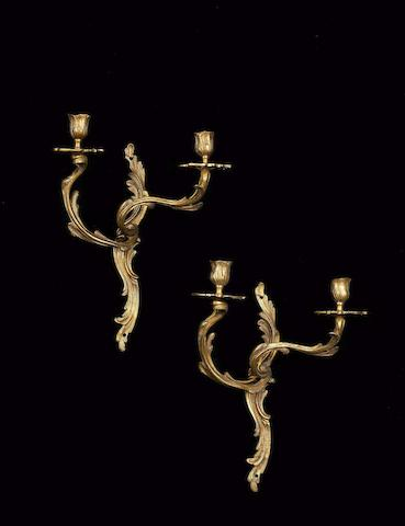 A set of four late 19th century gilt metal twin branch wall appliques in the Louis XV style