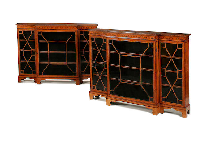 A pair of Edwardian satinwood and marquetry dwarf breakfront bookcases