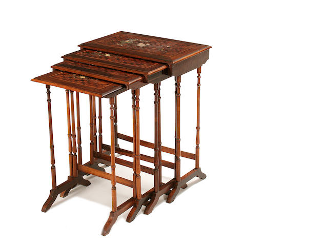 A set of four rosewood, marquetry and parquetry quartetto tables