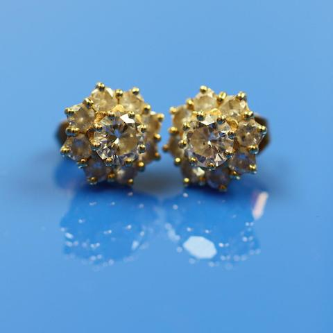 A pair of 18ct gold diamond cluster earstuds