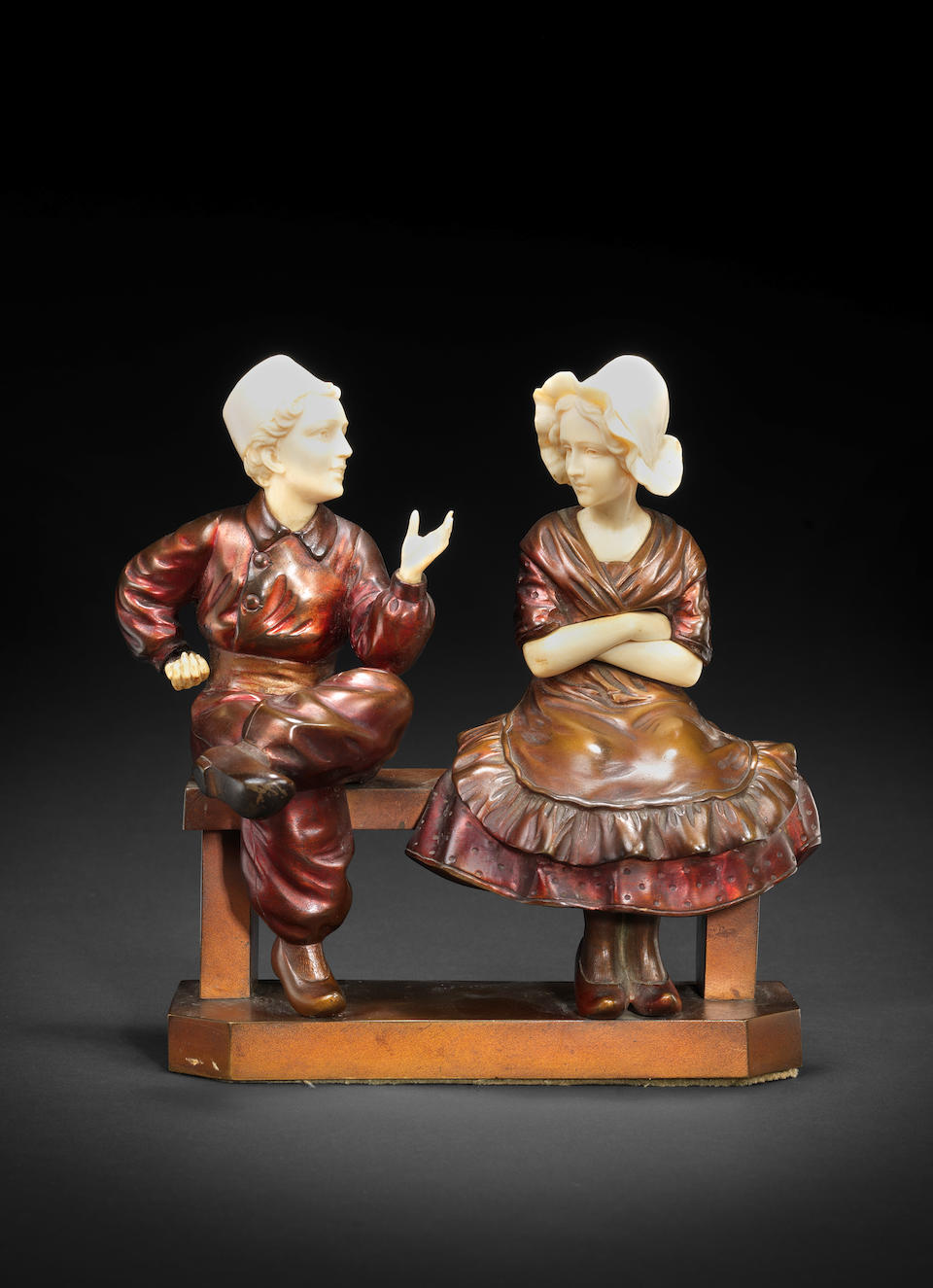Prof. Otto Poertzel A Cold-Painted Bronze and carved Ivory Figural Group, circa 1920