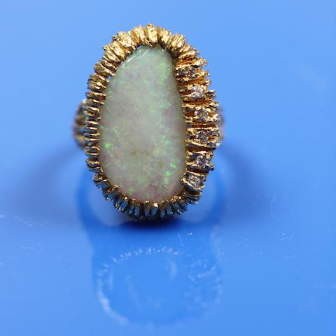 An opal and diamond cocktail ring