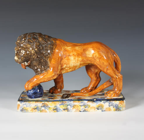 A Staffordshire Pratt Ware model of a lion Circa 1800-10.