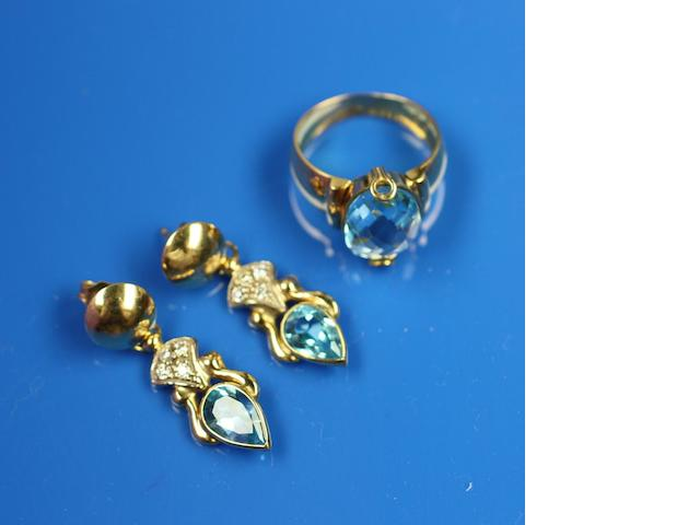 A blue topaz earring and ring suite