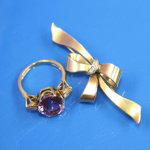 An amethyst and diamond ring and a diamond bow brooch